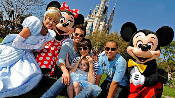 """Mission: Impossible"" star Tom Cruise and his family draw a crowd of admirers in front of Cinderella Castle at the Magic Kingdom."