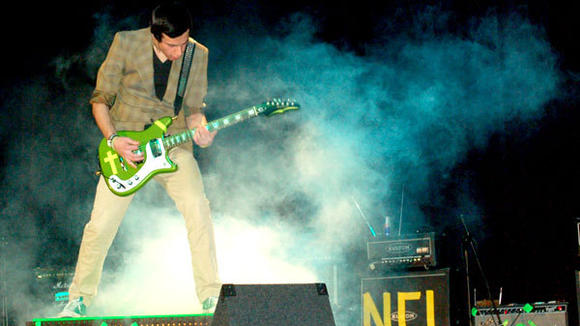 Stephen Cooper, lead guitarist of Sub-Section (C), rises from the smoke at Gaylord High School¿s Battle of the Bands.