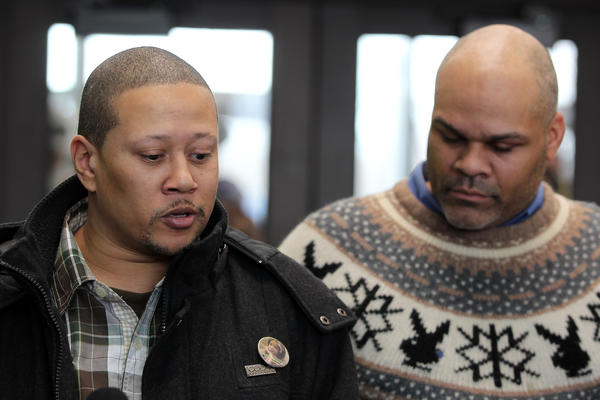 David Smith, left, and Ray Hill, friends of the Pendleton family, speak after bond court hearing.