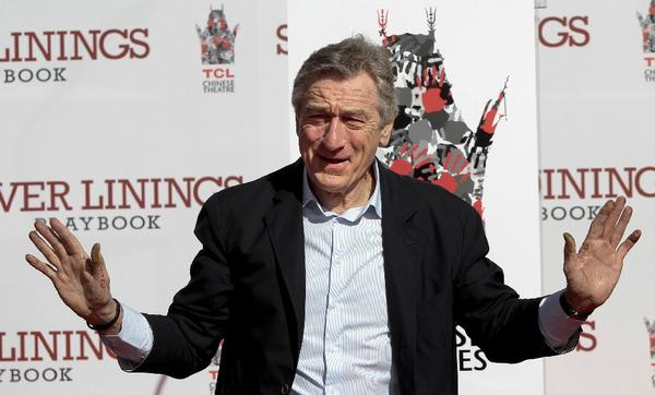Robert De Niro gets his hands dirty at a recent ceremony at the Chinese Theatre in Hollywood.