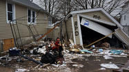 Superstorm Sandy earned its name, the National Hurricane Center reported on Tuesday, in a report that says the storm was the deadliest to hit the region in 40 years and the second costliest in the nation's history.