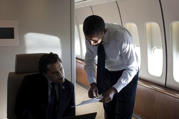President Obama talks with Cody Keenan, now chief White House speechwriter, aboard Air Force One in 2011.