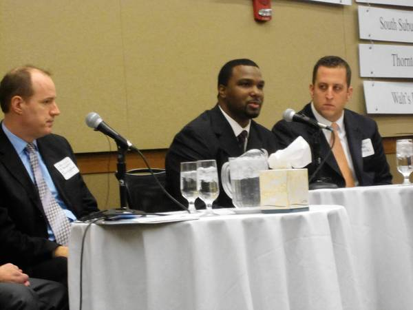 State Senators, from left, Bill Cunningham, D-Chicago, Napoleon Harris, D-Flossmoor, and Mike Hastings, D-Orland Hills, address members of the Chicago Southland Chamber of Commerce during a luncheon in Tinley Park Monday.