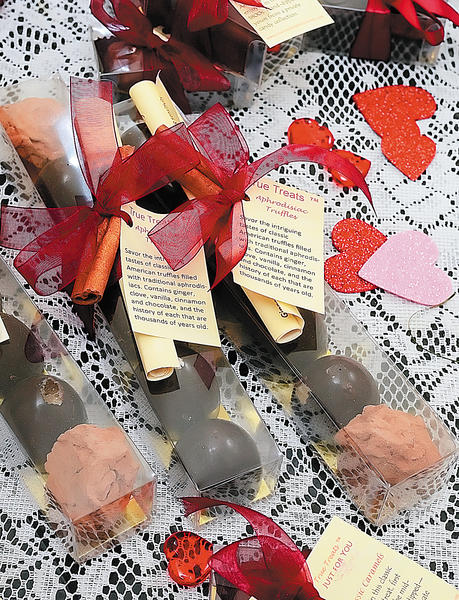 Susan Benjamin's aphrodisiacs include chocolate truffles flavored with ginger, cinnamon, vanilla and other strong-flavored foods. She says that while chocolate might not be an aphrodisiac, it serves a purpose.