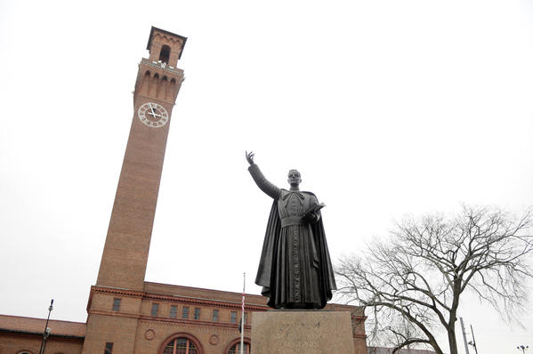 A statue of Rev. Michael J. McGivney, founder of the Knights of Columbus, and a Waterbury native, stands at the foot of Grand Street in front of the Republican-American building.