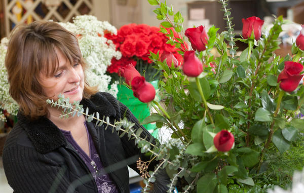 Floral designer Doris Getter, of Schnecksville, works on an arrangement of red roses for Valentines day at Mycalyn Florals on Main Street in Nazareth on Tuesday. With Valentines Day arriving on Thursday, local stores are ramping up to put together arrangements for their clients.