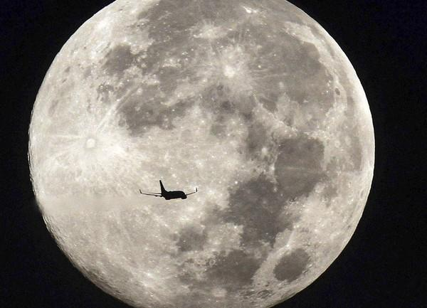 During a full moon last August a commercial jet leaving Orlando International Airport passes in front of the natural satellite of our solar system.