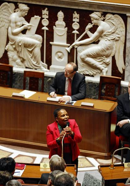 French Justice Minister Christiane Taubira speaks after National Assembly lawmakers voted on a bil that would legalize same-sex marriage.