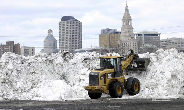 The parking lot of Dillon Stadium in Hartford is one of several dumping locations for mountains of the region's snow.