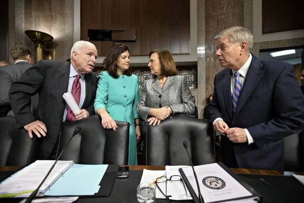 Sens. John McCain (R-Ariz.), left, Kelly Ayotte (R-N.H.), Deb Fischer (R-Neb.) and Lindsey Graham (R-S.C.) of the Senate Armed Services Committee. All 11 Republicans present voted against the Hagel nomination.
