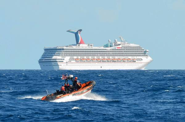 A small boat belonging to the Coast Guard Cutter Vigorous patrols near the cruise ship Carnival Triumph in the Gulf of Mexico. The Triumph has been floating aimlessly since a fire knocked out the ship's propulsion system.