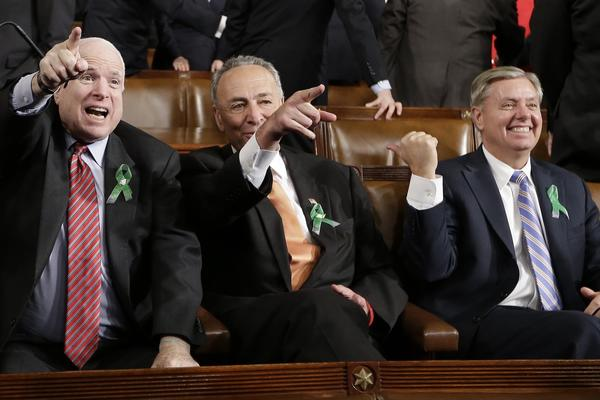 Sen. John McCain (R-Ariz.), Sen. Charles Schumer (D-N.Y.), and Sen. Lindsey Graham (R-S.C.) sit before the State of the Union address.