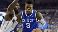 GAINESVILLE, Fla. — Kentucky's Nerlens Noel rushed back on defense, blocked Mike Rosario's layup from behind and then awkwardly landed on his left leg.