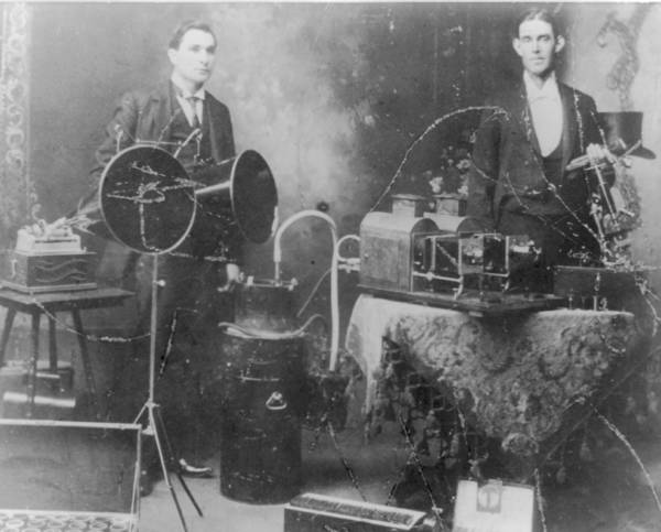 James Warren and Mr. Stockwell with an Edison phonograph with two horns, wax cylinder recordings and projector.