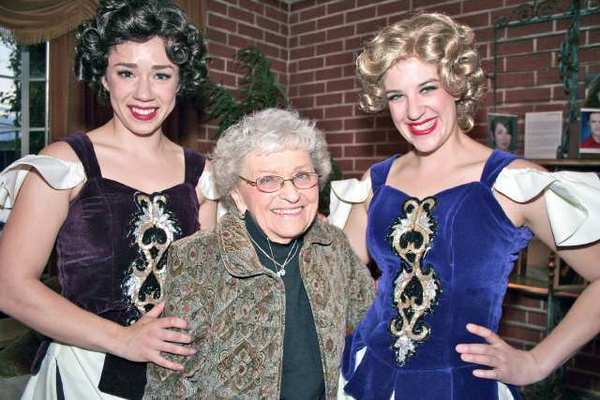 'Crazy for You' showgirls, from left, Daron O'Donnell and Anna LaMonica pose with Burbank resident Lillian Giese at the Glendale Center Theatre.