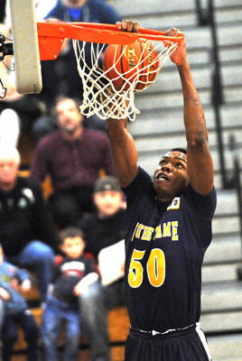 Notre Dame's Vincent Eze makes a basket Tuesday . Action from Notre Dame of Green Pond against Bangor in boys Colonial League semifinals at Southern Lehigh High School Tuesday.