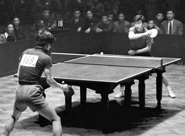 In this photo taken April 9, 1961, and released by New China News Agency, Zhuang Zedong, right, competes in the men's team finals of the 26th World Table Tennis Championship in Beijing.