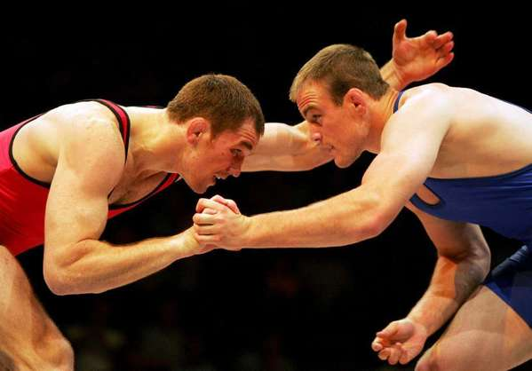 "The IOC's decision to drop wrestling from the Olympics ""might just awaken a sleeping giant,"" said former Olympic gold medalist Cael Sanderson, right, shown in a 2004 match against Malkaz Jorbenadze of the Republic of Georgia."