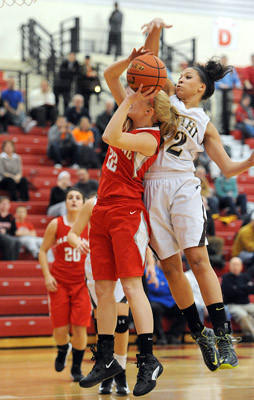 Bethlehem Catholic's Kalista Walters (right) blocks the ball away from Parkland's Callie Krajcir (left) during their Lehigh Valley Conference girls semifinal basketball game Tuesday night.