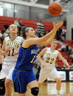 Nazareth's Lennon Kramer (front) chases down a rebound in front of Central Catholic's Alyssa Mack (left) during their Lehigh Valley Conference girls semifinal game Tuesday night.