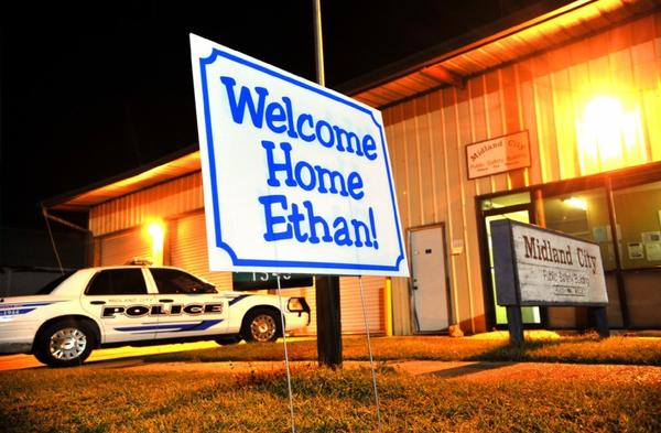 A sign in front of the Midland City Town Hall, where 5-year-old Ethan Gilman was kidnapped and held hostage in a bunker for nearly a week.