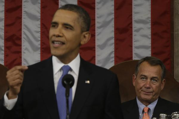 House Speaker John Boehner listens as President Obama gives his State of the Union address.