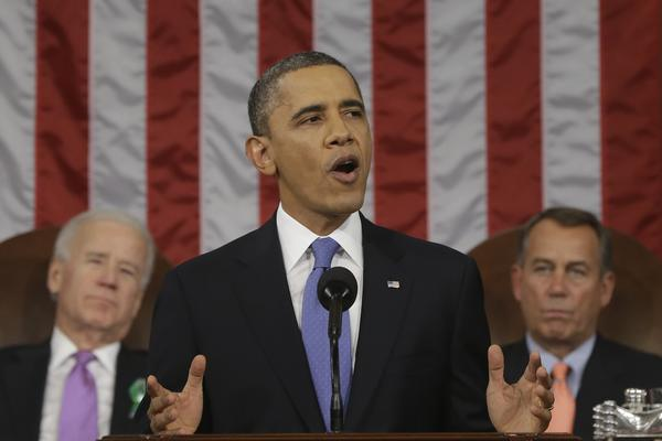 President Barack Obama, flanked by Vice President Joe Biden and House Speaker John Boehner, gestures during the State of the Union address before a joint session of Congress on Capitol Hill on Tuesday.