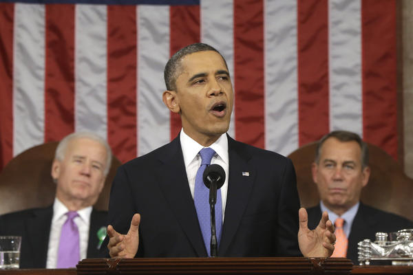 President Obama, flanked by Vice President Joe Biden and House Speaker John Boehner, gestures during his State of the Union address on Capitol Hill.
