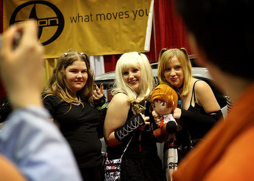 Women dressed in character pose for a photo at MegaCon 2011 at the Orange County Convention Center on March 26, 2011.