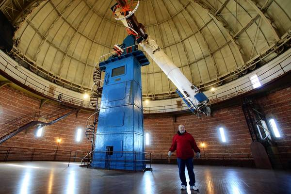 Richard Dreiser leads a tour of the Yerkes Observatory in Williams Bay, Wis. The facility, which opened in 1897 and is owned by the University of Chicago, is home to the largest refracting telescope in the world.