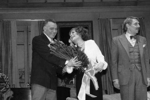 "Elizabeth Taylor receives roses from Richard Burton during the curtain call at the Broadway opening of Noel Coward's ""Private Lives"" in 1983."