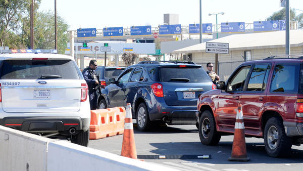 U.S. Customs and Border Protection officers inspect southbound cars at the Calexico downtown Port of Entry on Tuesday.