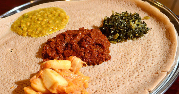 At Mariam's Restaurant this is a vegetarian wot platter featuring a red lentil wot. There are several vegetarian items on the menu there which includes Ethiopian and American cuisine.