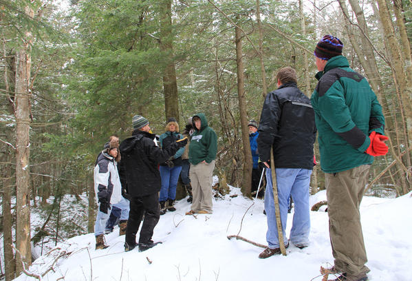 Tip of the Mitt Watershed Council briefs group of volunteers during a water quality monitoring event.