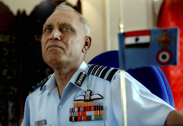 Former Indian air force chief Shashindra Tyagi listens to a question during a 2005 press conference at a military air base on the outskirts of Srinagar, India. On Wednesday, Tyagi denied involvement in an alleged kickback scheme involving payments from the Italian group Finmeccanica to facilitate a multimillion-dollar helicopter deal.