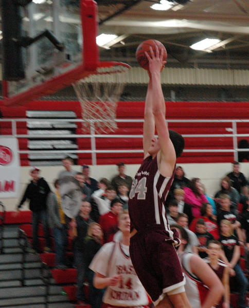 Charlevoix junior Zach Hankins goes up for a dunk during the first half of Tuesdays Lake Michigan Conference contest against East Jordan. The Rayders defeated the Red Devils, 77-52.