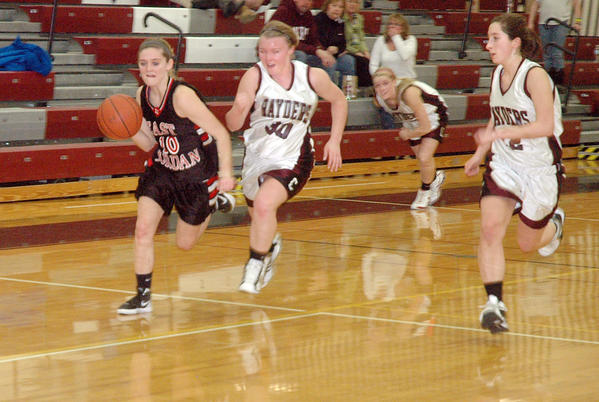 East Jordan senior guard Valerie Peters (left) pushes the ball up the floor as Charlevoixs Katie Hybl defends during Tuesdays Lake Michigan Conference contest at the Charlevoix High School gym.