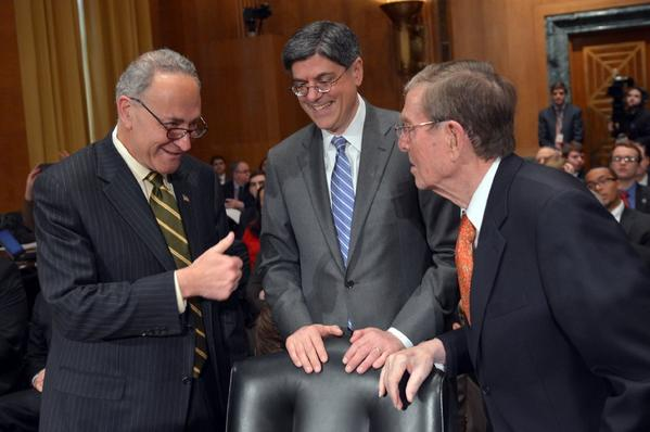 Jacob J. Lew, center, arrives to testify before the Senate Finance Committee on his nomination to be Treasury secretary, met by Sen. Charles E. Schumer (D-N.Y.), left, and former Sen. Pete Domenici (R-N.M.)., who introduced Lew to the panel.