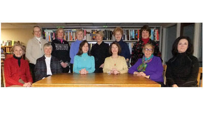 The Friends of the Petoskey Library board members gather to celebrate winning the top library friends in the state award. Members are (from left) Jane Damschroder, Ann Ingles, president Lauren Macintyre, Suzanne LaBeau, Carolyn Switzer, Noreen Tarquini; (standing) treasurer Joyce Hutto-Nolan, Lynnet Johnson, Anne Lewis, Jan Smith, Rhea Murray and second vice-president Mary Daniels. Not pictured are vice-president Peg Pinho and secretary Ann Barfknecht.