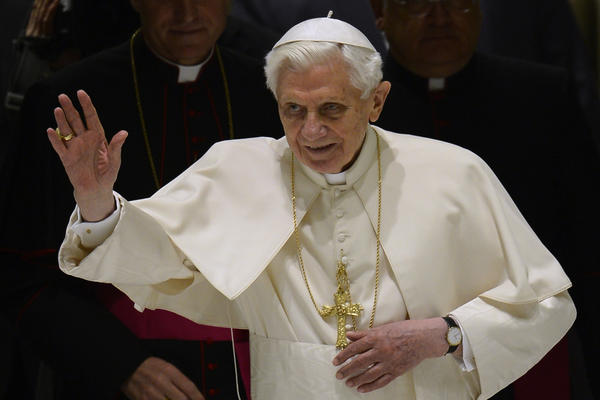 Pope Benedict XVI waves as he arrives for his weekly general audience at the Vatican.