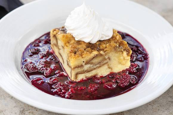 Pinon Grill¿s White chocolate bread pudding with berry compote
