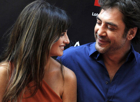 Spanish actress Penelope Cruz talks with her husband Spanish actor Javier Bardem during the opening of the 'street of stars' in Madrid on June 27, 2011.