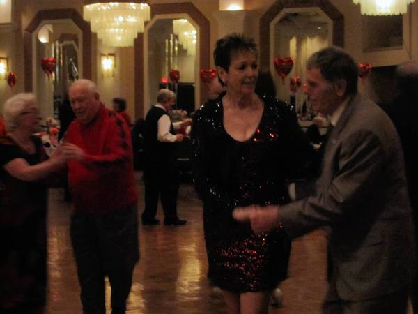 Frank Placek, right, and Louise Pennington take to the dance floor during the Orland Township Valentine Dinner Dance for seniors last week.