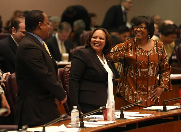 New 7th Ward Ald. Natashia Holmes takes her seat between Alds. Roderick Sawyer, 6th and Michelle Harris, 8th, after she was sworn into office during the City Council meeting Wednesday.