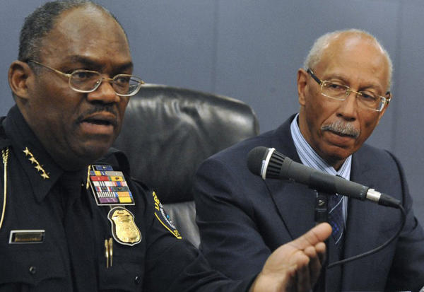 Detroit Police Chief Chester Logan, left, and Mayor Dave Bing discuss the city's rising crime at a news conference last month. But it is not the only issue facing the city.