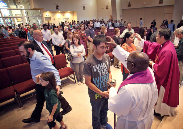Believers receive ashes during the traditional Ash Wednesday service, at the John XXIII Roman Catholic Church, Miramar, on Wednesday February 13, 2013.