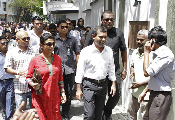 Former Maldives President Mohamed Nasheed, center, prepares to enter the Indian embassy in Male.