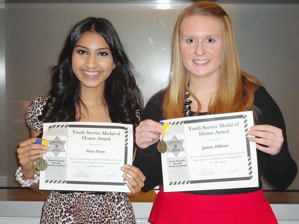 Nisa Khan and Jamie Hillner (right) receiving the Cook County Sheriff's Youth Service Medal of Honor Award.