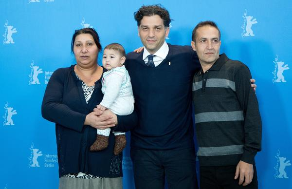 """Director Danis Tanovic is flanked by Senada Alimanovic and her son, Danis, and Nazif Mujic at the Berlin Film Festival, where their movie """"An Episode in the Life of an Iron Picker"""" is showing."""