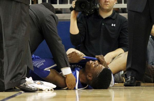Kentucky Wildcats forward Nerlens Noel reacts on the ground after hurting his knee against the Florida Gators. X-rays were negative but there is no word on how long Noel, considered the top prospect in the upcoming NBA draft, may be out. The Wildcats are in danger of missing the NCAA tournament after rolling to the title last season.